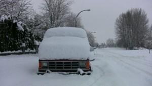 snow covered van